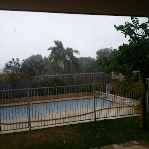 Driving rain over the pool